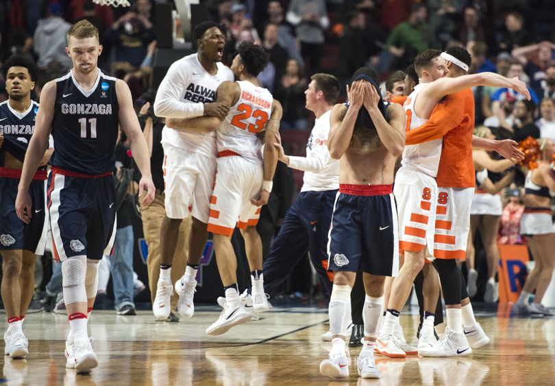 Gonzaga's Silas Melson, Domantas Sabonis and Josh Perkins feel the pain after being beaten by  Syracuse in the Sweet 16, March 25, 2016, at the United Center in Chicago. (Dan Pelle / The Spokesman-Review)