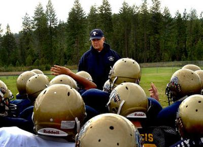 Head coach Roy Albertson of Timberlake, gathering his players at practice on Tuesday, returns just two of 22 starters from last year's Intermountain League championship team.   (Kathy Plonka / The Spokesman-Review)