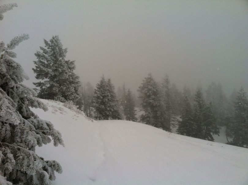Fog drifts in and out at Bogus Basin Ski Resort on Sunday, as the resort opened the backside of the mountain for the first time this season (Betsy Russell)