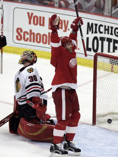 Associated Press Detroit winger Dan Cleary celebrates his third-period goal. (Associated Press / The Spokesman-Review)