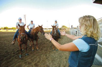 Angie Brown provides instructions to this year's fair royalty in the rodeo arena at the Walla Walla County Fairgrounds.   (Associated Press / The Spokesman-Review)