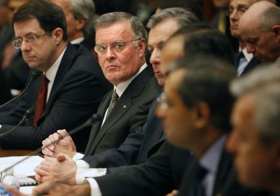 Bank of America  CEO Kenneth Lewis, center, with Bank of New York Mellon CEO  Robert Kelly, left, and other top bankers  testify before the House Financial Services Committee. (Associated Press / The Spokesman-Review)
