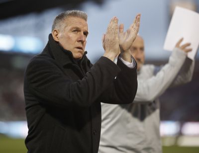 In this March 24, 2018 photo, Sporting Kansas City's Peter Vermes acknowledges fans as he takes the pitch to lead his team against the Colorado Rapids in an MLS soccer match in Commerce City, Colo. Major League Soccer coaches are welcoming the opportunity to use five substitutes when play resumes in Florida next month, out of concern for both player fitness and the summertime heat. The adoption of the rule and the expansion of game-day rosters are especially important given the relatively short preparation time teams have had for the MLS Is Back Tournament, which starts July 8, 2020, at the sports complex at Walt Disney World.  (Associated Press)