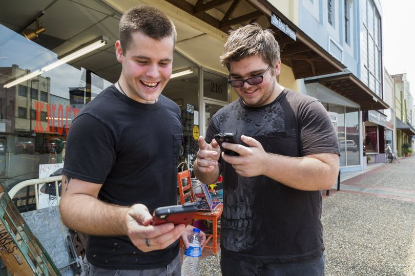 Brothers Jon and Ryan Edmonds play the augmented-reality smartphone game Pokémon Go in downtown Texarkana, Arkansas on Saturday. Released July 5, the game allows players to
