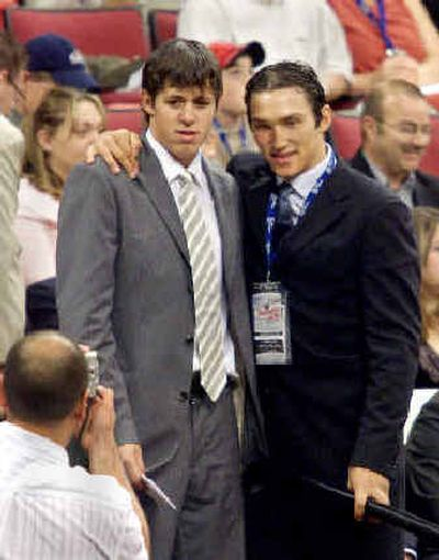 Evgeni Malkin, left, of Russia, poses with fellow countryman Alexander Ovechkin after the two were taken with the first two picks in the NHL draft.   (Associated Press / The Spokesman-Review)