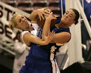 Feb.20 2009 Nampa, Idaho, USA; Coeur d' Alene Kama Griffitts battles for the ball with Centennial's Taylor Hagood (21) in the closing seconds of overtime verse the Centennial Patriots during the Championship  game at the Idaho Center in Nampa.  STEVE CONNER Special to The Spokesman-Revieww (Steve Conner / The Spokesman-Review)