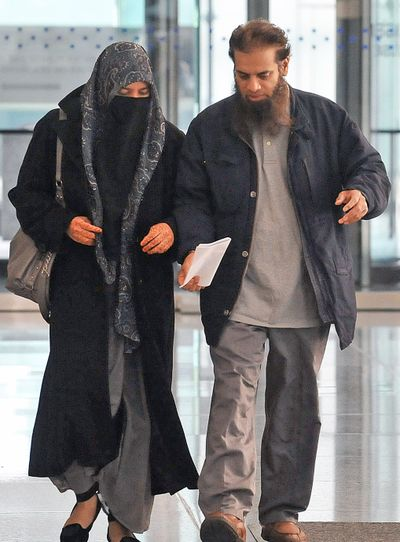 The parents of Mohammed Hamzah Khan, a 19-year-old from Bolingbrook, Ill., leave federal court Monday in Chicago. (Associated Press)