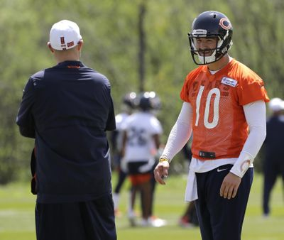 In this May 22, 2019 photo, Chicago Bears quarterback Mitchell Trubisky, right, smiles as he talks with head coach Matt Nagy during NFL football practice in Lake Forest, Ill. Trubisky is facing some lofty expectations. Bigger things are expected in his second season under coach Matt Nagy and with the Chicago Bears winning the NFC North to reach the playoffs for the first time in eight years. (Nam Y. Huh / Associated Press)