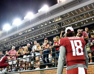 Fans cheer as Washington State Cougars quarterback Anthony Gordon heads to the locker room during Washington State's win over New Mexico State in 2019. (Tyler Tjomsland / Tyler Tjomsland/The Spokesman-Review)