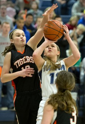 Zeroing in: LC's Riley Lupfer goes after G-Prep's Laura Stockton for a block and jump ball during Prep's 38-35 victory. Roundup of Tuesday's area boys, girls action /B4 (Dan Pelle)