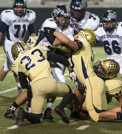 Mead and Mt. Spokane would still play each other under the new alignment, but their game would not count in league standings. (Colin Mulvany)