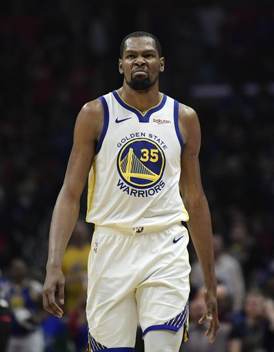 Golden State Warriors forward Kevin Durant will miss at least the first two games of the Western Conference Finals against the Portlant Trail Blazers. (Mark J. Terrill / AP)