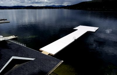 The concrete pier at Lloyd Herman's Liberty Lake home is one of the unauthorized structures on his property that violates shoreline rules. The state Court of Appeals has upheld a $30,000 fine over the violations.   (File / The Spokesman-Review)