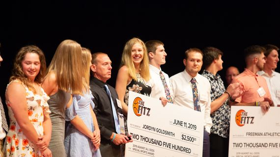 Jordyn Goldsmith, along with the Freeman High School Athletics Department, receives a check for the