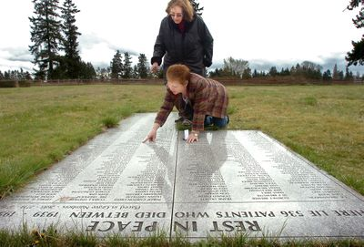 On April 8, Laurel Lemke, standing,  and Rosemary Chaput examine a memorial  their group installed in 2006 at Western State Hospital Cemetery.  (Associated Press / The Spokesman-Review)