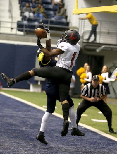 Eastern Washington wide receiver Shaq Hill, right, fights for the ball in the end zone  against Northern Arizona  on Saturday. (JAKE BACON / Associated Press)
