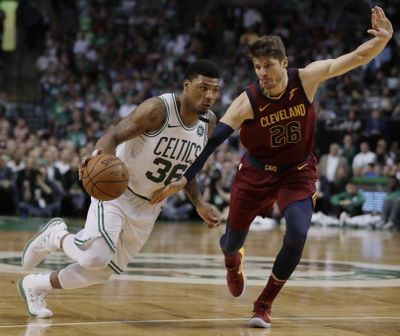 Boston Celtics guard Marcus Smart, left, drives against Cleveland Cavaliers guard Kyle Korver during the second half in Game 2 of the NBA basketball Eastern Conference finals, Tuesday, May 15, 2018, in Boston. (Charles Krupa / Associated Press)