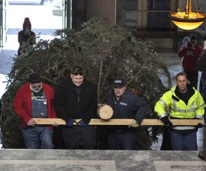 OLYMPIA -- State workers carry the Holiday Kids' Tree into the Capitol Friday morning before decorating it ahd hoisting it into its stand in the middle of the Rotunda. (Jim Camden/The Spokesman-Review)