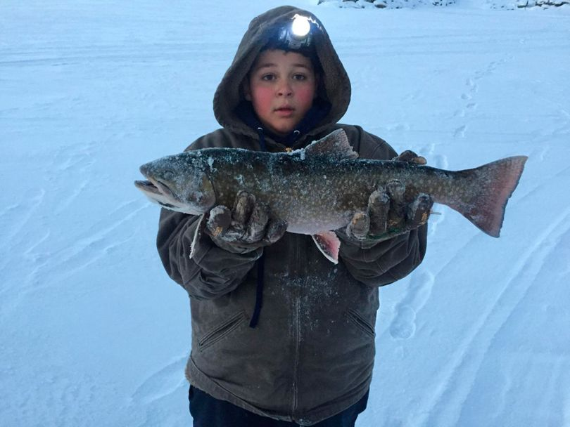 Kazen Cromar, 10, poses with his 22-inch-long Idaho catch-and-release record brook trout caught in December 2016 at Henry's Lake.  (Courtesy)