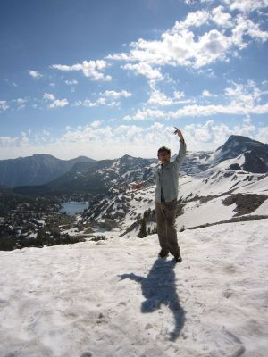 Jeff Lambert of the Spokane Mountaineers poses in the last weekend of July 2011 along with Mirror Lake and Eagle Cap Peak from Carper Pass -- all popular backpacking destinations in the Eagle Cap Wilderness. (Jeff Lambert)
