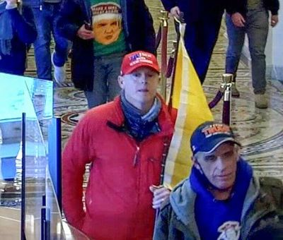 According to the FBI, Joseph Elliott Zlab, center in red, was captured on photos and in video footage entering the U.S. Capitol on Jan. 6 with a pro-Trump mob that sought to disrupt Congress' certification of the 2020 presidential election results.  (FBI)