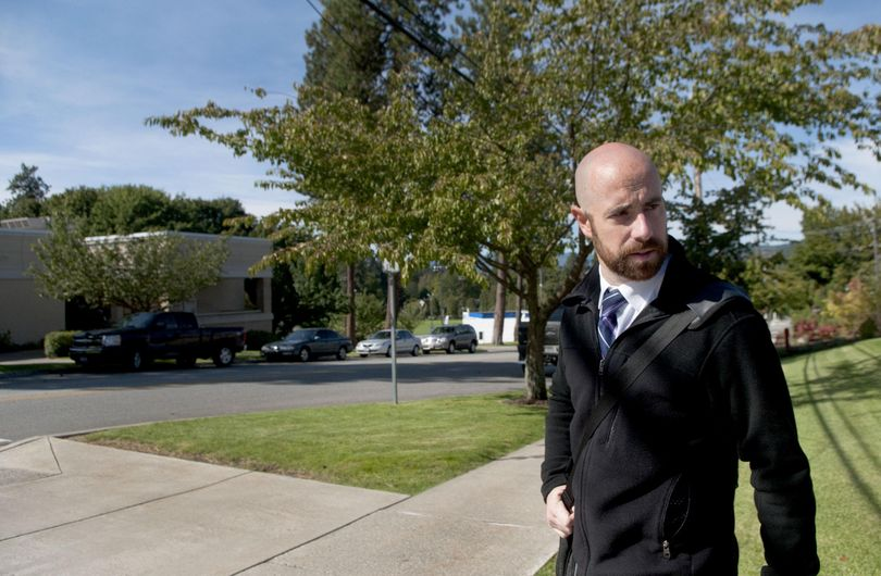 Coeur d'Alene attorney Luke Malek arrives at the courthouse to review files pertaining to an upcoming case on Sept. 9. (Kathy Plonka / The Spokesman-Review)