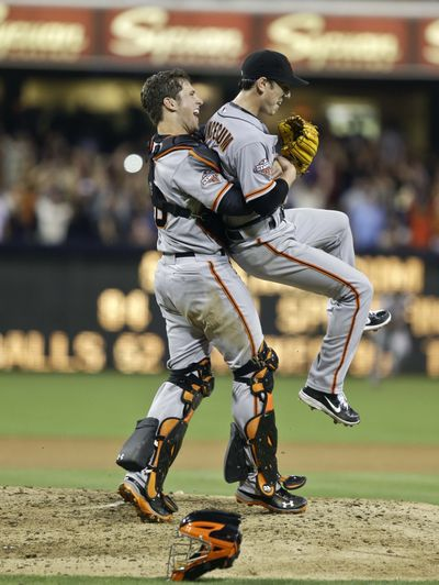 Giants catcher Buster Posey lifts Tim Lincecum after Saturday's no-hitter against San Diego. (Associated Press)