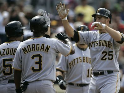 Pittsburgh's Adam LaRoche, right, lost a home run Wednesday after a video replay.  (File Associated Press / The Spokesman-Review)