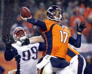 Denver Broncos quarterback Brock Osweiler (17) throws against the New England Patriots during the second half of an NFL football game, Sunday, Nov. 29, 2015, in Denver. The Broncos won 30-24.(AP Photo/Joe Mahoney)