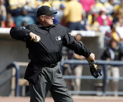 Umpire Rick Reed is rehabbing by working in the minor leagues after suffering two strokes.  (Associated Press / The Spokesman-Review)