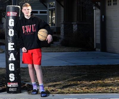 Salk Middle School student Dylynn Groves poses in front of his family's home in Spokane earlier this month before his brothers – EWU basketball standouts Tanner and Jacob Groves – played in the NCAA Tournament.
