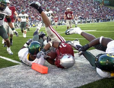 Dwight Tardy bowled over some Ducks last season in Pullman.   (File / The Spokesman-Review)