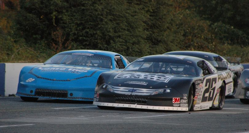 Bubba Pollard (26) and Garrett Evans (64) race side-by-side for the lead at the Evergreen Speedway Summer Showdown.  They finished first and second respectively. (Photo Credit M.E. Wright)