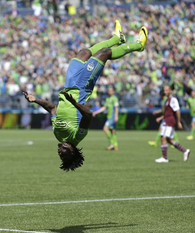 Obafemi Martins throws celebratory backflip after scoring Seattle's fourth goal. (Associated Press)
