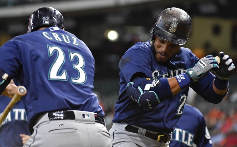 Seattle's Robinson Cano, right, celebrates his three-run home run off Houston Astros starting pitcher Doug Fister with Nelson Cruz in the first inning  Wednesday  in Houston. (Eric Christian Smith / Associated Press)