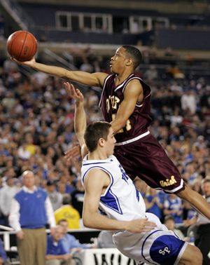 New WSU recruit Reggie Moore in 2006 playing for O'Dea in the 3A championship game.  (John Froschauer / The Spokesman-Review)