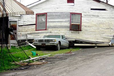 A home rests on top of a car in New Orleans after Hurricane Katrina. Although this picture was taken in March, similar damage can still be seen across the city.  (Craig Parker / The Spokesman-Review)