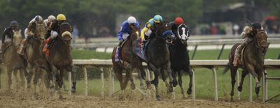 Calvin Borel squeezes Mine That Bird into the lead along the rail en route to Kentucky Derby victory.  (Associated Press / The Spokesman-Review)