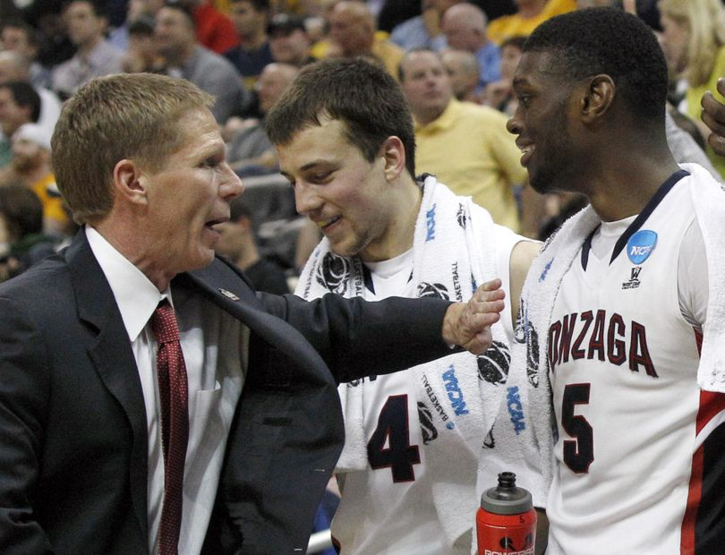 Mark Few congratulates his two young freshmen, Kevin Pangos, left, and Gary Bell, Jr. in their first NCAA tournament back in 2012.