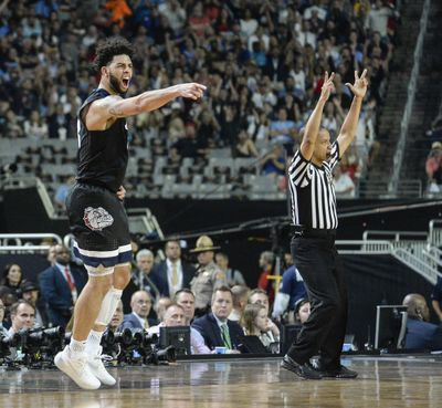 Gonzaga's Josh Perkins celebrates after sinking a 3-pointers against North Carolina on Monday. (Dan Pelle / The Spokesman-Review)