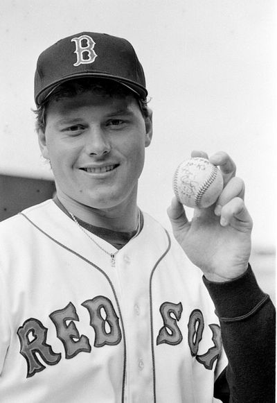 Boston Red Sox pitcher Roger Clemens poses with the game ball at Fenway Park in Boston on Wednesday, April 30, 1986. Clemens set a Major League Baseball record by striking out 20 batters against the Seattle Mariners. (ELISE AMENDOLA / AP)