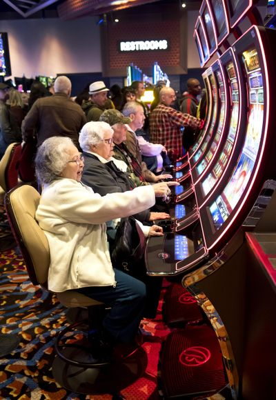 Lori Thomas plays a video gaming machine during the January 2018 grand opening of the Spokane Tribe Casino in Airway Heights. (Colin Mulvany / The Spokesman-Review)