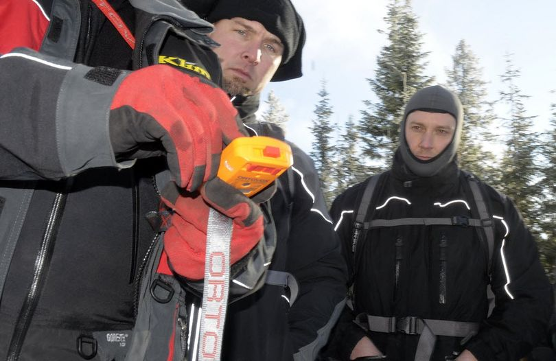 Larry Dowd ( back center ) and James Mittelstadt ( rear right ) of Rathdrum, Idaho learn about avalanche beacons in an Avalanche Awareness Class during a demonstration at the Fourth of July snowmobile area today.  (Christopher Anderson / The Spokesman-Review)