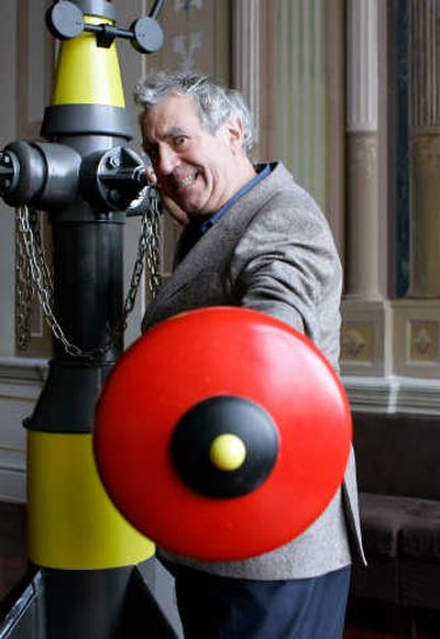 Terry Jones poses with a contraption used on stage in his opera
