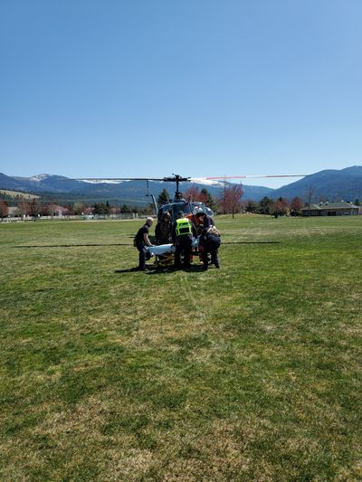 Flight crews on the Spokane County Sheriff's Office's Air 1 helicopterhoisted an injured hiker after a fall in Liberty Lake Regional Park and flew her to Pavilion Park, shown here, where she was treated by AMR.  (Courtesy of SCSO Air 1 Twitter)
