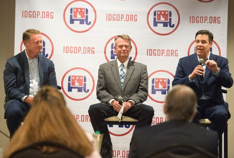 FILE – Idaho Rep. Raul Labrador, right, speaks as Lt. Gov. Brad Little, center, and Tommy Ahlquist, left, listen during an Idaho GOP forum for 2018 candidates for governor in Coeur d'Alene on July 21, 2017. All three are proposing major tax cuts as they seek the open Idaho governor's seat in 2018. (Tyler Tjomsland / The Spokesman-Review)