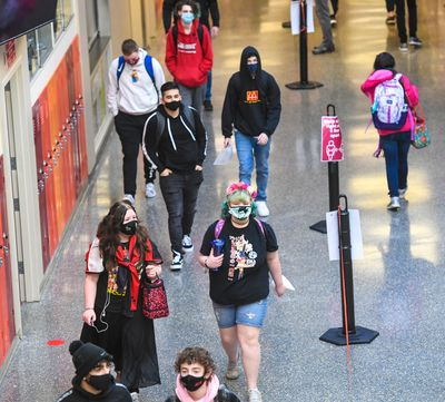 North Central High School students keep to the right in the hallways and throughout the building as they attend in-person classes for the first time this school year, March 1, in Spokane.  (DAN PELLE/THE SPOKESMAN-REVIEW)