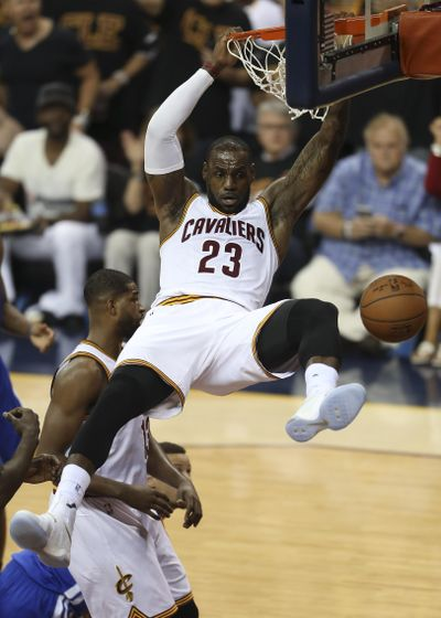 Cleveland Cavaliers forward LeBron James  dunks against the Golden State Warriors during the first half of Game 6 Thursday in Cleveland. (Ron Schwane / Associated Press)