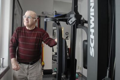 Steve Charchan stands next  to equipment at Caribou Physical Therapy, where he received care  Jan. 6  in Sandpoint. Charchan inherited some money and created Heavenly Helping Hands, a charity that supports students going into physical or occupational therapy.  (Jesse Tinsley / The Spokesman-Review)