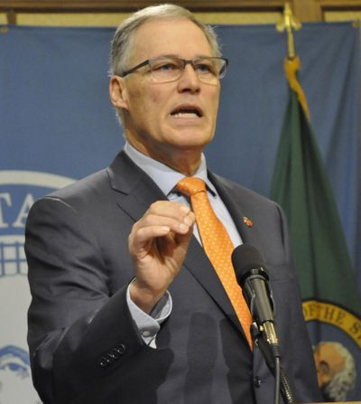 OLYMPIA -- Gov. Jay Inslee tells reporters Washington is ready to defend its system of legal marijuana and is confident in its position opposing President Trump's restrictions on immigration during a press conference on Feb. 9, 2017. (Jim Camden / The Spokesman-Review)